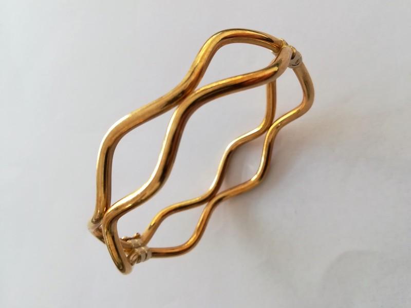 bracciale oro giallo rigido filo ondulato