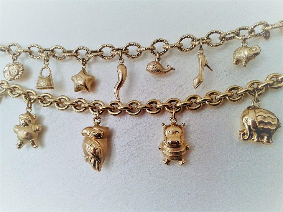 bracciali in oro giallo con pendenti charms